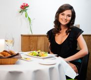 Lady alone in restaurant Stock Photos
