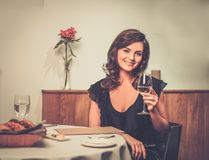 Lady alone in restaurant Royalty Free Stock Image