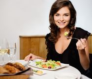 Lady alone in restaurant Stock Photography