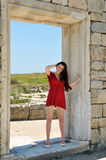 Lady in ancient ruins. Lady in red standing near ancient ruins Royalty Free Stock Photography
