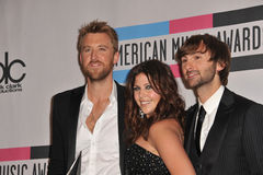 Lady Antebellum, Dave Haywood, Charles Kelley, Hillary Scott,. Lady Antebellum stars Dave Haywood, Hillary Scott & Charles Kelley at the 2011 American Music royalty free stock images
