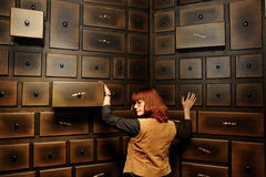 Lady by the antique cabinet Royalty Free Stock Image