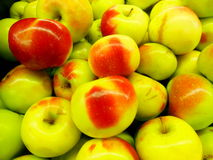 Lady Apples. The Lady apple has thin satin-finished pale lime green skin blushed with layered tones of ruby and crimson and nearly invisible white freckles Royalty Free Stock Image