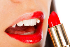 Lady applying Lip Gloss Royalty Free Stock Photo