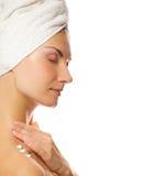 Lady applying moisturizer Stock Images