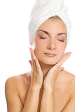 Lady applying moisturizer Stock Photo
