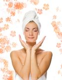 Lady applying moisturizer Stock Photography
