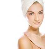Lady applying moisturizer Stock Image