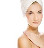 Lady applying moisturizer stock image
