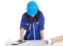 Lady architect witth clipboard and blueprint Royalty Free Stock Image