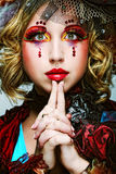 Lady with artistic make-up.Doll style. Stock Photo
