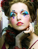 Lady with artistic make-up.Doll style. Royalty Free Stock Photo
