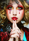 Lady with artistic make-up.Doll style. Stock Images