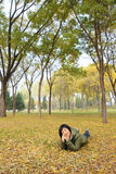 Lady in autumn. The Chinese woman was lying in autumnal forest stock photography
