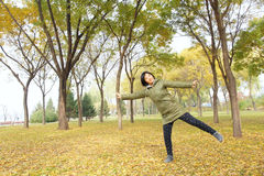 Lady in autumn. The Chinese woman was playing in autumnal forest royalty free stock photos