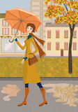 Lady and autumn city Stock Images