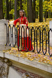 Lady in autumn forest. Lady in medieval red dress in the autumn forest Stock Images