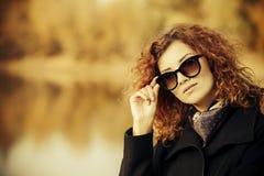 Lady in autumn Stock Photo