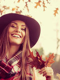 Lady with autumnal leaf. Royalty Free Stock Images