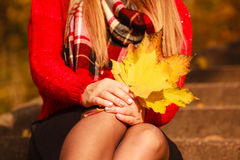 Lady with autumnal leaf. Stock Photo