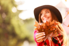 Lady with autumnal leaf. Stock Photos