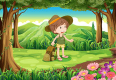 A lady with a backpack and a hat at the forest Stock Images