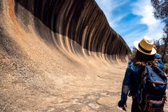 Lady backpack travel in Wave rock. National park, Australia stock photo