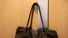 Lady bag hang on the door Royalty Free Stock Image