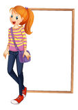 A lady with a bag standing in front of an empty board Stock Images