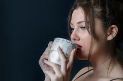 Lady with bangs holding a cup Stock Photo