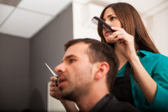 Lady barber cutting hair Royalty Free Stock Photo