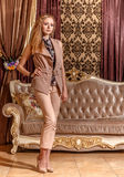 Lady in the baroque styled room Stock Photography