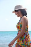 Lady on the beach. Young asian lady walking along the beach royalty free stock images