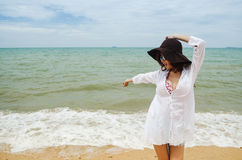 Lady on the beach Stock Photography