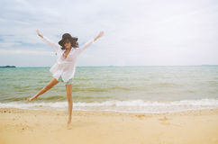 Lady on the beach. Beautiful asian lady wearing white shirt walking on the beach stock images