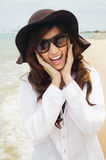 Lady on the beach. Close up shot of a beautiful lady wearing white shirt agianst the beach stock photos