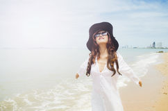 Lady on the beach. Close up shot of a beautiful lady wearing white shirt agianst the beach royalty free stock photos