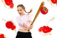 Lady beating off tomatoes with a baseball bat Stock Photography