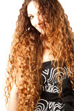 Lady with a beautiful brown curly hair Royalty Free Stock Image