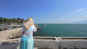 Lady and beautiful view on bay stock footage