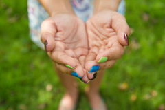 Lady beg something with colorful nails Stock Images