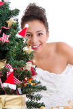 Lady behind christmas tree Stock Photography