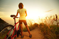 Lady with bicycle stock images