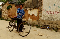 Lady with Bicycle in Communal Village Stock Image