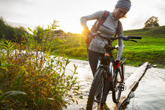 Lady with bicycle Stock Photos