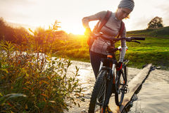 Lady with bicycle Stock Photography