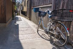 Lady bicycle or Electric Bike on the Street near a wooden house. Wall royalty free stock images