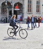 Lady in Bicyle at Market Square, Bruges Royalty Free Stock Images