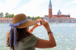 Lady with a big straw hat taking a picture in the basin of San M Royalty Free Stock Photo
