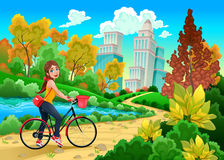 Lady on a bike in a urban park Stock Photos